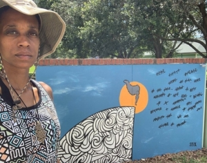 Alexis Stix Brown with I Am Safe Mural