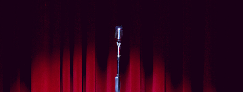 Stage with Microphone and Red Curtains - Auditions